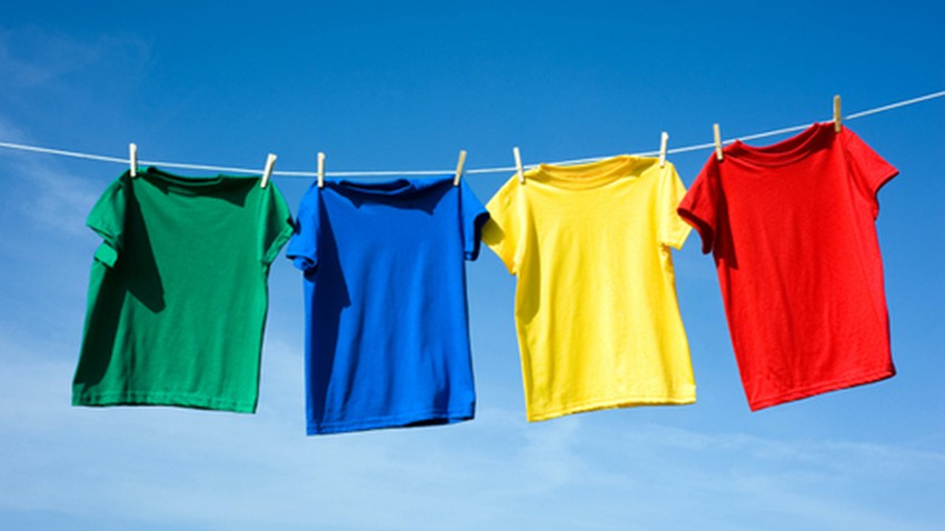 What is the relationship of clothing colors to heat absorption