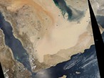 What are the similarities between the dark storm and the expected sandstorm on Friday in Arabia